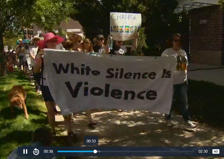 Marchers with Silence is Violence sign